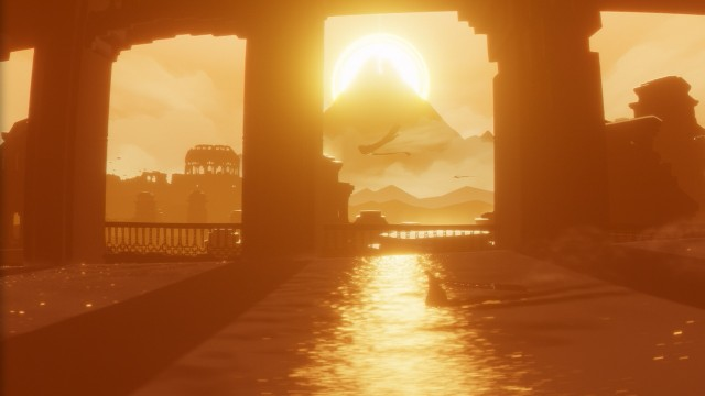 The glow of the mountain flanked by sun in Journey