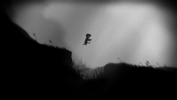Limbo protagonist leaps a small ravine filled with spikes